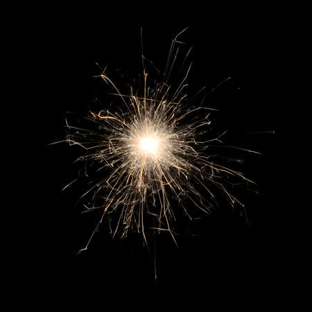 Burning sparklers isolated on black background. Small fireworks giving off sparks of fire. Sparks explosion.