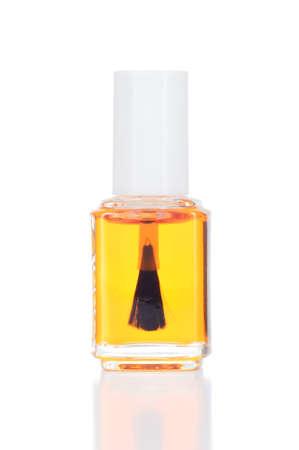 nail care: Nail and cuticle oil isolated on white  Natural oils for nail care and manicure treatment