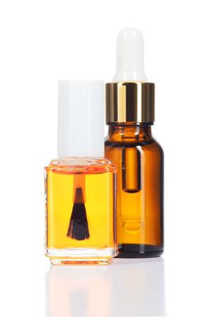 oleos: Dos aceites naturales para el cuidado de la belleza aislados en blanco Foto de archivo