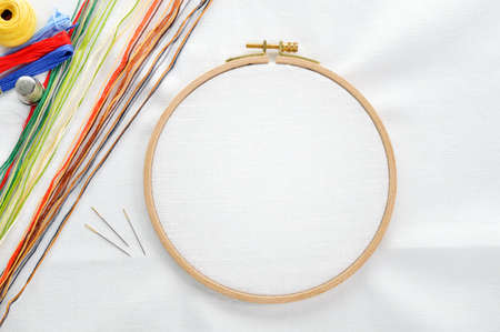 Embroidery set  White linen fabric, embroidery hoop, colorful threads and needls  Copy space