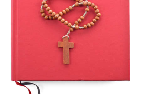 sacramental: Wooden plain rosary on red book - Holy Bible  Stock Photo