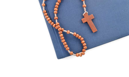 sacramental: Wooden plain rosary on Bible  Studying the Holy Bible