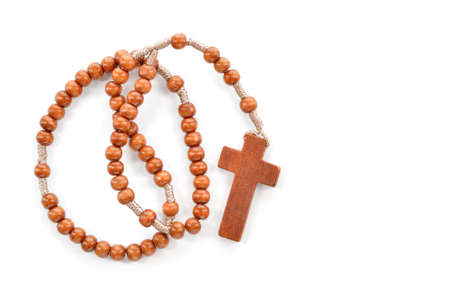 sacramental: Wooden plain rosary on white background  Prayer beads use to count the repetitions of prayers - rosary of Virgin Mary