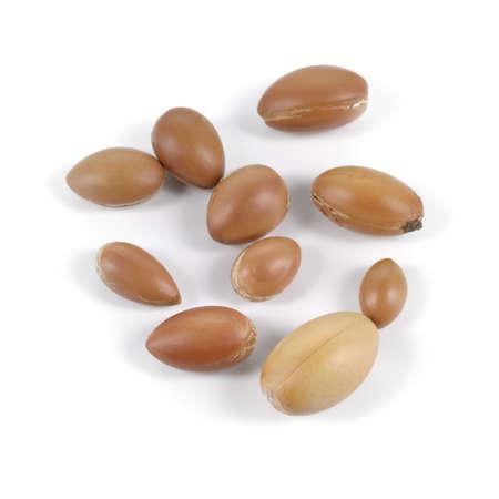 Large group of argan nuts on a white background. Plenty of copy space. Horizontal studio shot.
