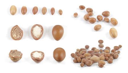Set of isolated groups of argan nuts on white background  Stock Photo