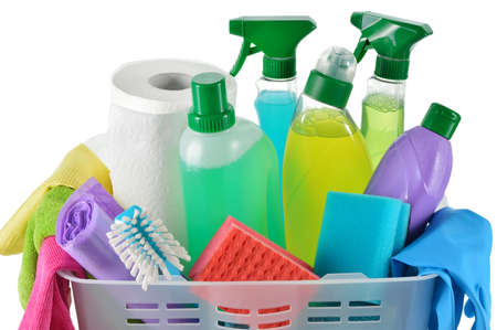 Close up of cleaning products and supplies in a basket  Cleaners, microfiber cloths, gloves in a basket isolated on white background  Cleaning kit