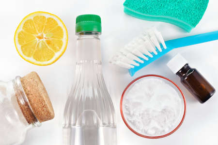Eco-friendly natural cleaners  Vinegar, baking soda, salt, lemon and essential oil  Homemade green cleaning on white background
