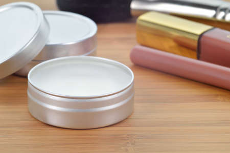 Pure shea butter in metallic tin on a wooden background  Perfect lip balm and beauty balm against of other lip cosmetics  Daily care for lips  photo
