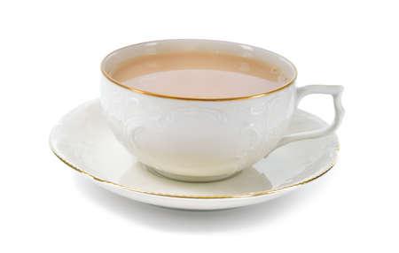 ホワイト バック グラウンド磁器カップとソーサーは繊細なレリーフ構造とゴールドの装飾で分離されたアンティークの磁器のカップにミルク入り紅 写真素材