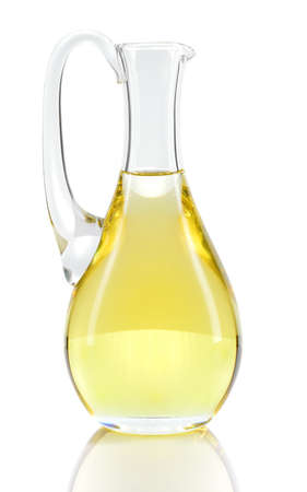 Rapeseed oil in decanter isolated on white background  Canola oil rich in Omega-3  Stock Photo