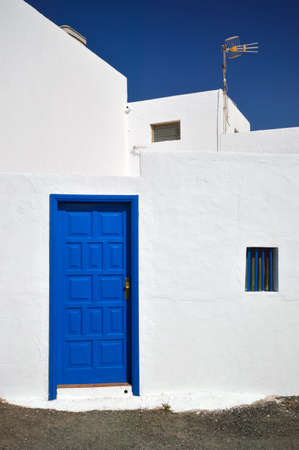 golfo: Typical canarian white building with blue door  Architecture, El Golfo village Lanzarote, Canary Islands