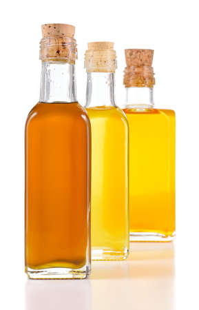 unsaturated: Healthy oils with unsaturated fats. Nigella sativa oil, poppy seed oil and flax oil in a bottle isolated on white background. Cold pressed non refined oils.
