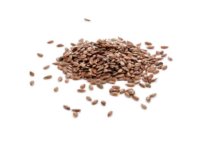 linum usitatissimum: Pile of brown flax seeds isolated on white background. Flax seeds are rich in omega-3 fatty acid.