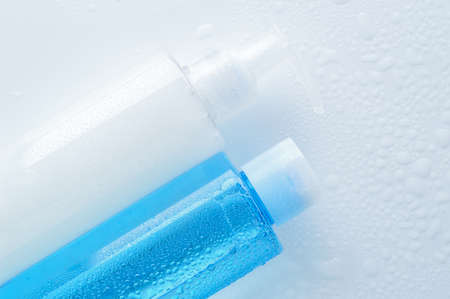 toner: Daily cleansing cosmetics - face wash cleansing gel, smoothing toner with water drops on white background. Copy space.