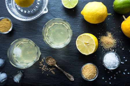 electrolyte: Nimbu Pani Indian lemonade, refreshing drink for hot days. Home made natural isotonic made with water, lemon juice, sugar, salt and cumin. Top view.