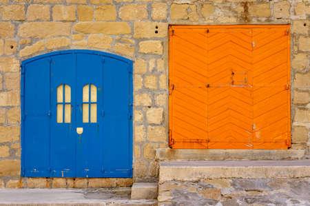 Fisherman's huts, Island of Gozo, Inland Sea, Malta. Blue and orange door.