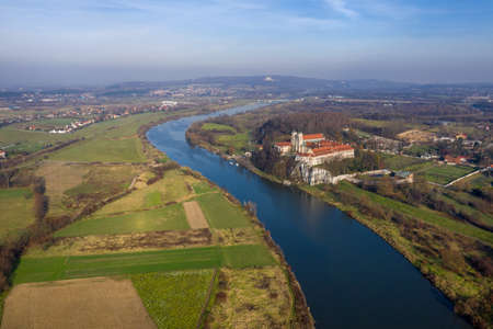 Aerial view of Tyniec Benedictine abbey, Vistula river, Cracow and Silver Mount with Camaldolese Hermit Monastery. Poland, autumn day.