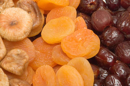 Assortment of dried fruits: figs, apricots and dates Stock Photo