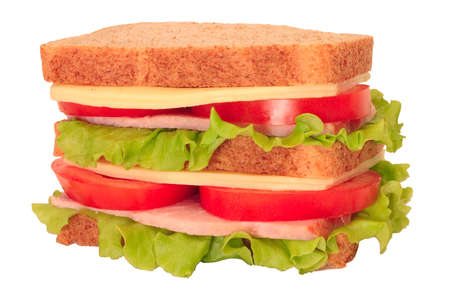 Large sandwich with cheese, ham, tomatoes and lettuce, isolated on white background