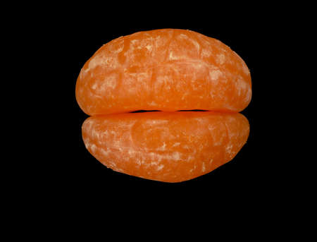 Lips composed of two mandarin segments, isolated on black background