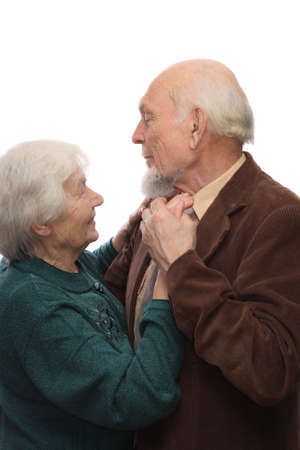 Senior couple dancing, man man holding woman's hand, isolated on white background