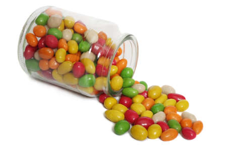 Jar with spilling jelly beans, isolated on white background Stock Photo