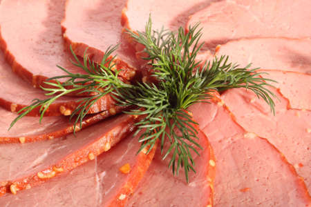 Beef slices and dill leaves, close-up