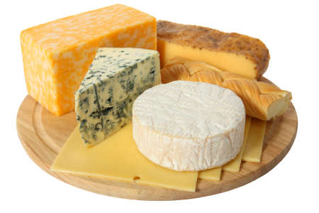 Various types of cheese on wooden platter Stock Photo