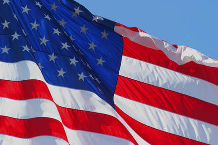 flapping: United States flag flapping in the wind Stock Photo