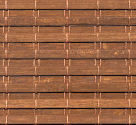 A close-up of a section of bamboo window blinds