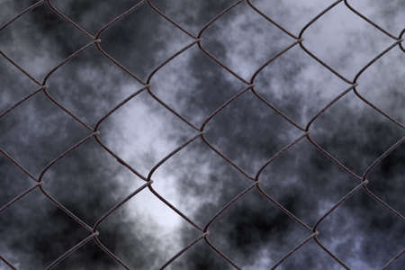 Chain link fence with cloudy night background