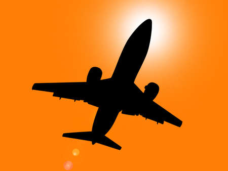 directly: Silhouette of jet aircraft flying overhead at sunset with sun directly behind cabin.
