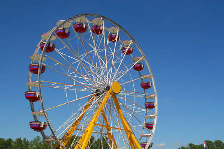 Ferris wheel at state fair set against clear blue sky background