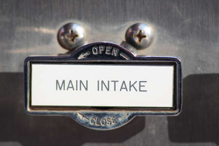 Close-up of main water pressure intake valve handle on fire engine truck Stock Photo