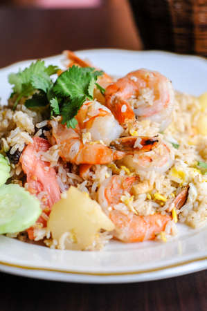 Pineapple Fried Rice, Stir-fried rice with egg, pineapple, raisins, cashew nuts, green onions and tomatoes. Stock Photo