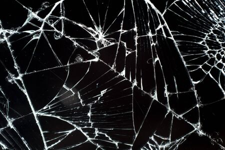 Cracked touch screen smartphone, background texture