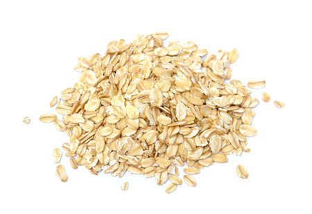 pile of fresh oat flakes isolated on white background