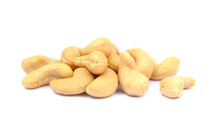 Tasty salted cashew nuts on a white background Stock Photo