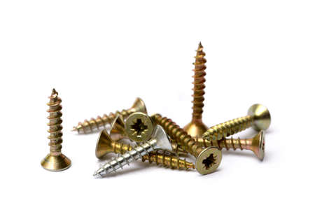 Pile of wood screws isolated on white background Stock Photo