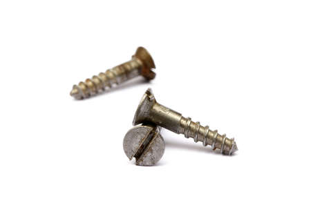 Scattered old wood screws isolated on white background