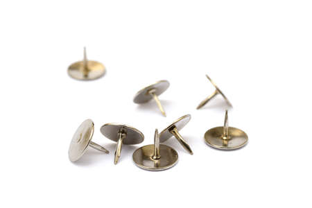 brads: Ordered pile pushpins isolated on white background