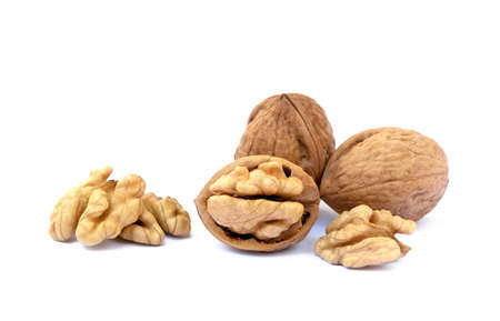 Pile of walnuts in shell isolated with white background
