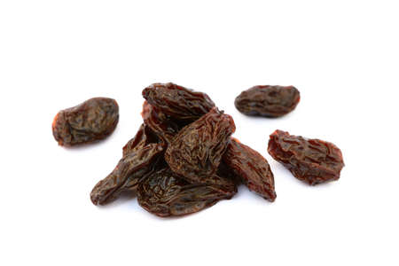 sultanas: Sweet dried raisins isolated with white background