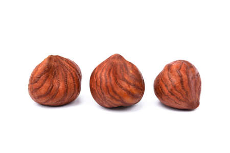 healty: Group healty hazelnuts isolated on white background