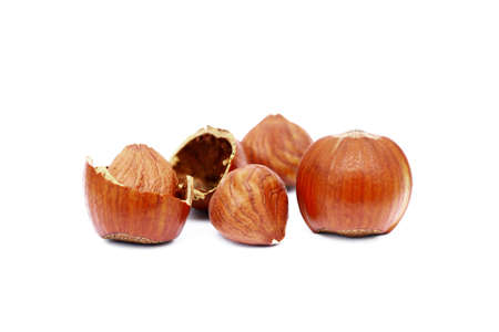 Group of fresh hazelnuts isolated on white background
