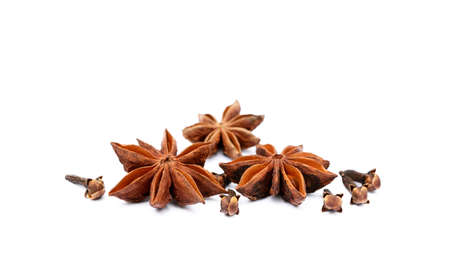 Aromatic star anise, cloves isolated on white background Stock Photo