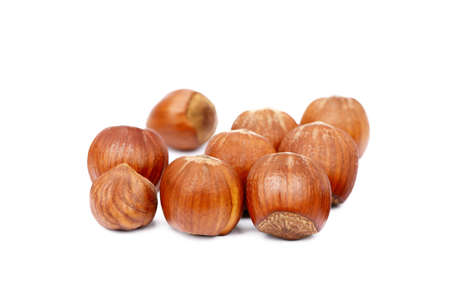 nutshells: Group of fresh hazelnuts isolated on white background