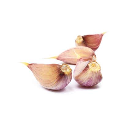 Fresh garlic cloves isolated on white background Stock Photo