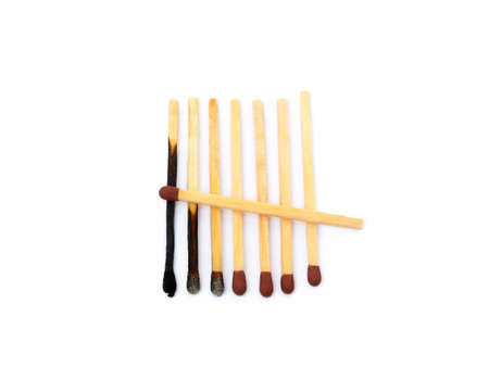 Laid Used Matchsticks isolated on white background