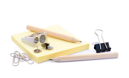 Office supplies isolated on white background, pencil, paper, staples, pencil sharpeners, pushpins